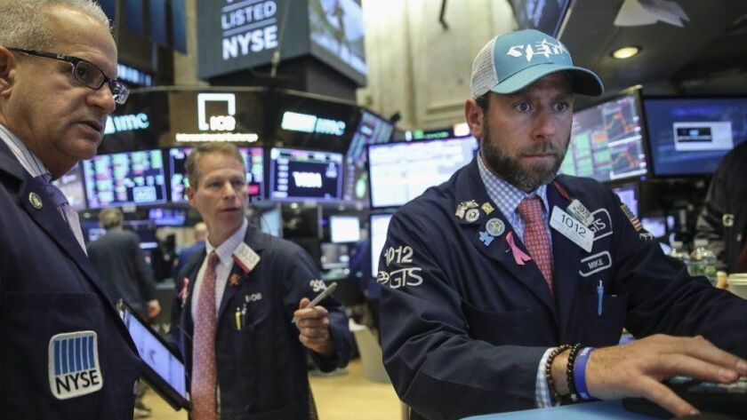 Traders and financial professionals work on the floor of the New York Stock Exchange at the opening bell Oct. 25, 2018, in New York City. The S&P 500 index is on pace for its worst month in a decade.