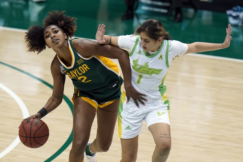 Baylor guard DiDi Richards (2) drives around South Florida guard Maria Alvarez (1) during the second half of an NCAA women's college basketball game Tuesday, Dec. 1, 2020, in Tampa, Fla. (AP Photo/Chris O'Meara)