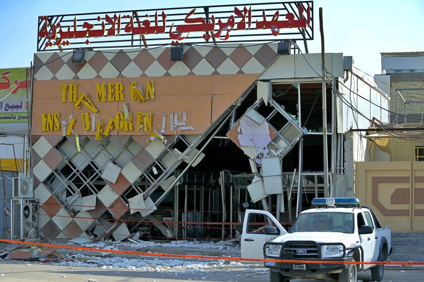 An explosive device damaged the facade of the American Institute for English Learning in Najaf, Iraq, on Friday.