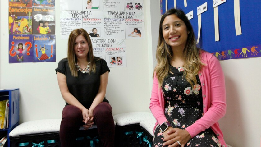 Two language teachers at Hogg Elementary in Dallas where school district recently began offering bilingual classes pairing native English speakers with native Spanish speakers.
