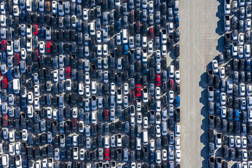 An aerial photo of many lines of parked cars