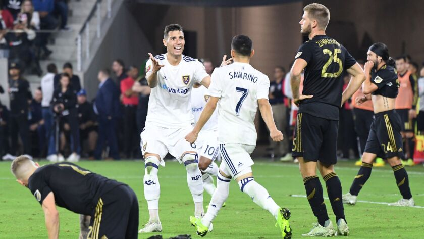 RSL's Jefferson Savarino (7) celebrates his go-ahead goal with Damir Kreilach to make the score 3-2 in the second half.
