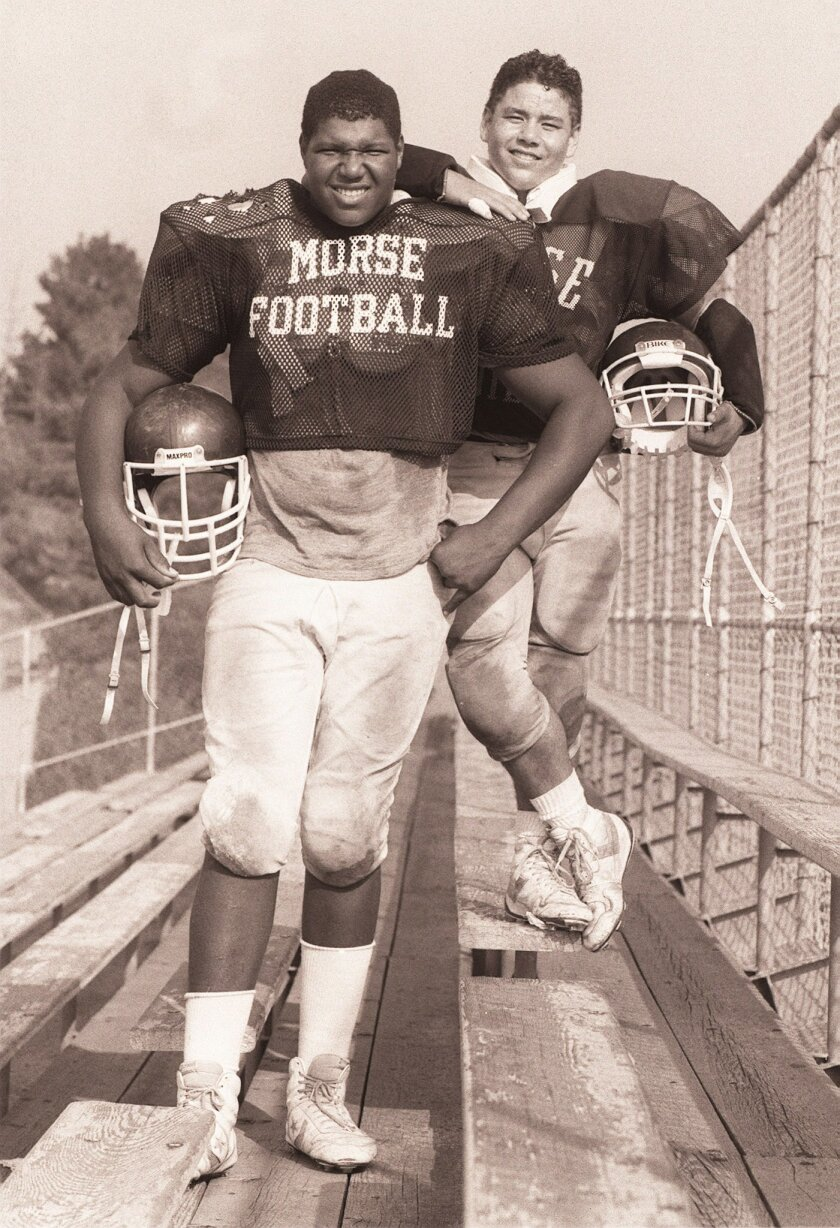 Lincoln Kennedy (shown with teammate Michael Orris in this 1987 photo), went from Morse High to the NFL and is now set for enshrinement in the San Diego Hall of Champions Hall of Fame.