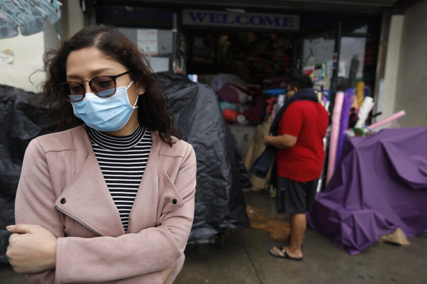 Charm Resuello, 26, wears a surgical mask while shopping in downtown Los Angeles.