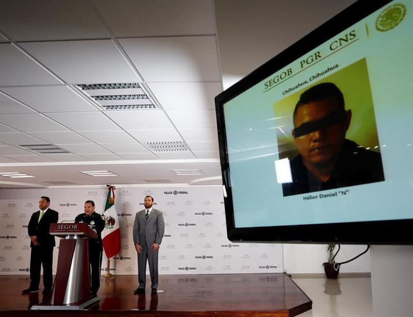 El comisionado general de la Policía Federal, Manelich Castilla (c), habla hoy, jueves 22 de febrero de 2018, durante una rueda de prensa, en Ciudad de México (México). EFE