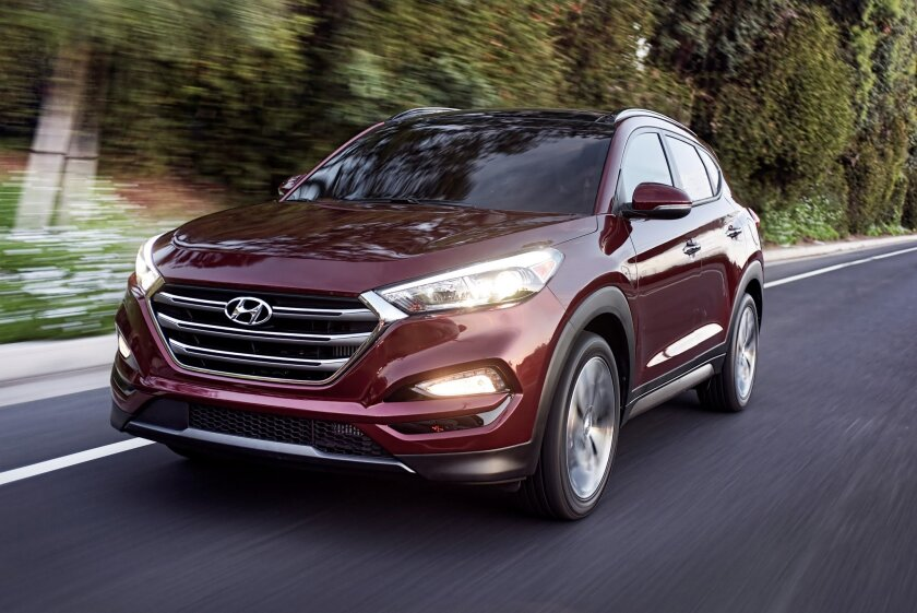 FILE - This photo provided by Hyundai Motor America shows the 2016 Hyundai Tucson.  Small SUVs did poorly in new headlight tests performed by the insurance industry. The Insurance Institute for Highway Safety says none of the 21 small SUVs tested earned its highest ranking. The Ford Escape, Honda C