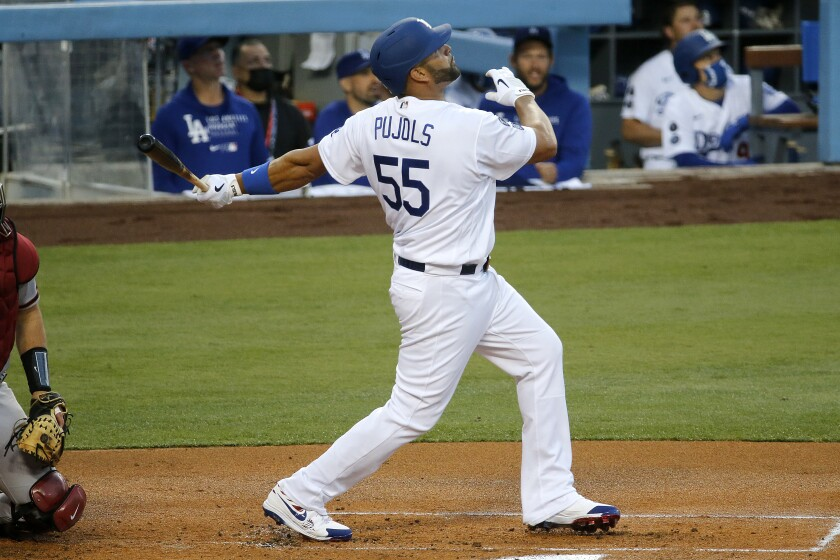 Dodgers first baseman Albert Pujols flies out to the outfield.