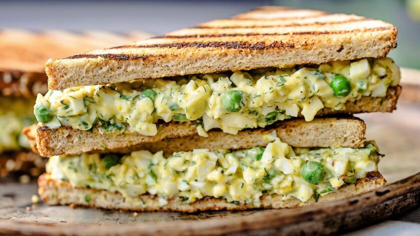 Spring peas and dill add color and flavor to egg salad.