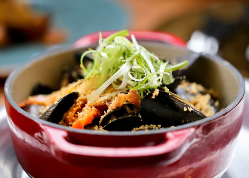 The wood-fired mussels with smoked tomato and beer broth at Fireside.