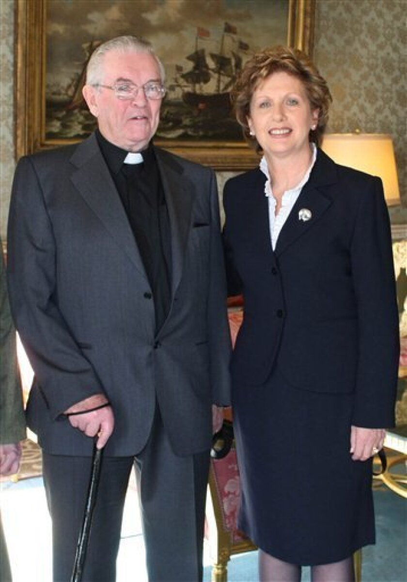 "FILE -- This is a Feb. 2008 file photo of the Rev. Aengus Finucane, left, and Ireland's President Mary McAleese. Finucane, a Roman Catholic missionary who braved civil war in Biafra as a pioneer of Irish aid efforts worldwide, died Tuesday, Oct. 6, 2009, his charity announced. He was 77. ""There can be few Irish people of his generation, or of any other generation, who have contributed as much to improving the lives of so much of humanity,"" said Tom Arnold, chief executive of the Concern charity that Finucane spent decades promoting. (AP Photo/Concern Worldwide/PA)"