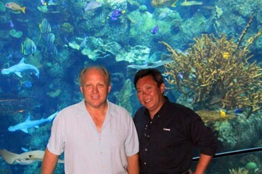 David Hinkel and Leon Chow are the owners of C & H Photo. Courtesy