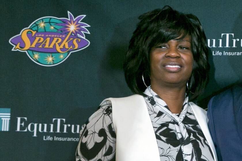 FILE - In this Dec. 7, 2018, file photo, Los Angeles Sparks executive vice president and general manager Penny Toler poses during a WNBA basketball news conference in Los Angeles. Former Los Angeles Sparks general manager Penny Toler is suing the WNBA team saying she was fired for raising complaints about inappropriate sexual relationships involving the team president and a managing partner, not for using a racial slur. (AP Photo/Damian Dovarganes, File)