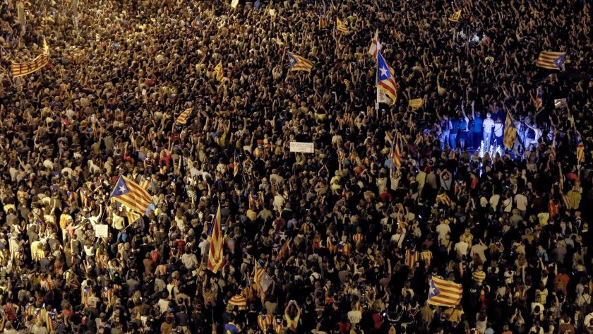 Protesters favoring an independence referendum for Spain's Catalonia region demonstrate in Barcelona