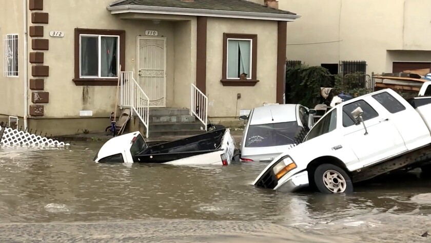 Several vehicles are submerged after a water main break in South Los Angeles.