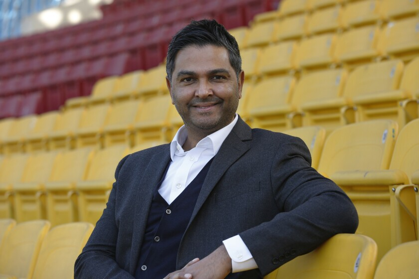 """In this Nov. 20, 2020, photo, Chief Executive of the Pakistan Cricket Board Wasim Khan poses for a photo after an interview with The Associated Press, at Gaddafi stadium in Lahore, Pakistan. Pakistan is ready to host major cricketing nations like South Africa, New Zealand, England and West Indies in 2021 after seeing only the sport's lesser-lights in the past five years. """"We're working hugely in terms of building relationships, nurturing those relationships with (other) cricket boards,"""" Khan told The Associated Press. (AP Photo/K.M. Chaudary)"""