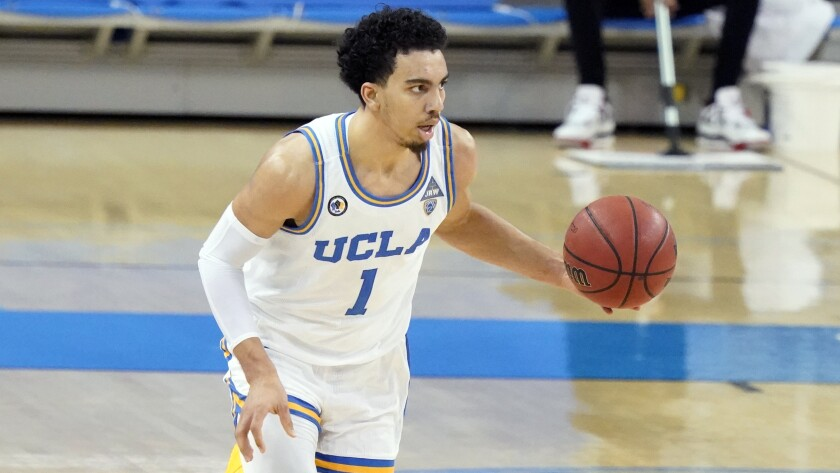 UCLA guard Jules Bernard dribbles during a game against Colorado on Jan. 2.