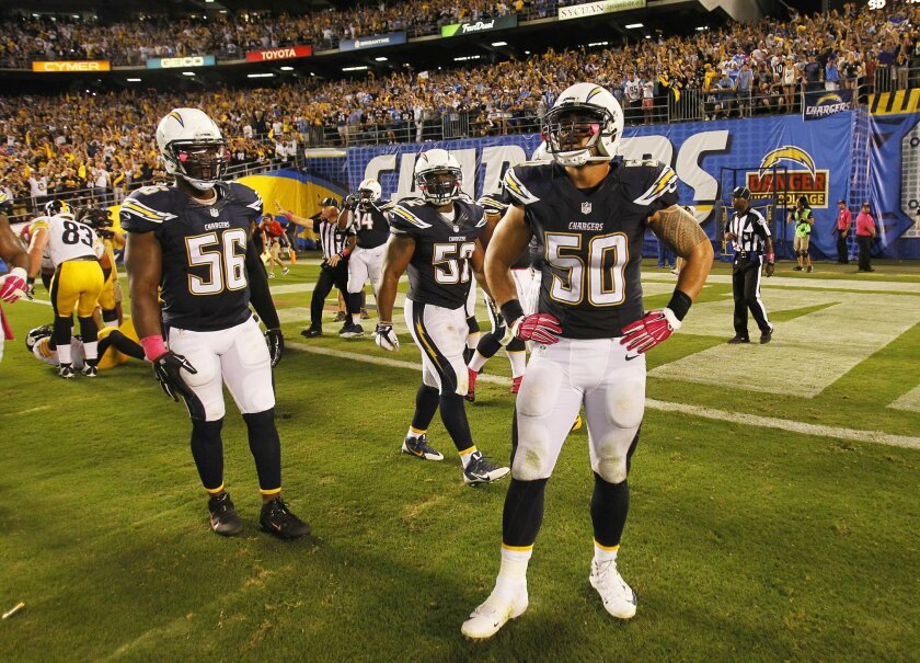 Chargers Donald Butler (56) and Manti Te'o stand in disbelief after Steelers Le'Veon Bell ran in the game winning touchdown in the 4th quarter against the Chargers.