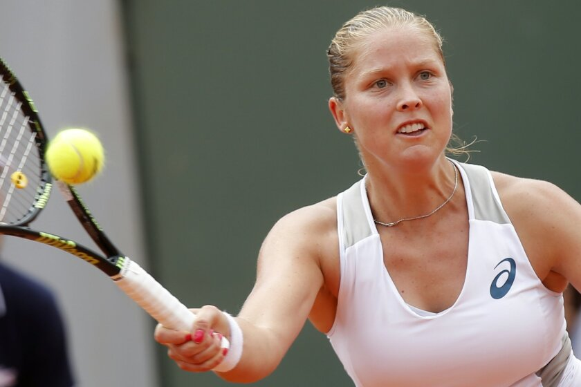 Shelby Rogers of the U.S. returns in her third round match of the French Open tennis tournament against Petra Kvitova of the Czech Republic at the Roland Garros stadium in Paris, France, Friday, May 27, 2016. (AP Photo/Michel Euler)