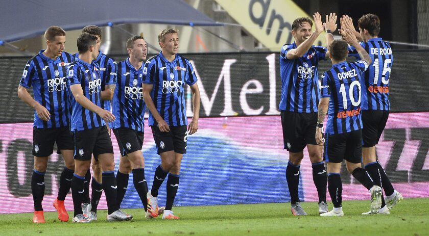Atalanta's players celebrate after Robin Gosens scored his side's 2nd goal during a Serie A soccer match between Atalanta and Napoli, at Bergamo's Stadium, northern Italy, Thursday, July 2, 2020. (Giuseppe Zanardelli/LaPresse via AP)