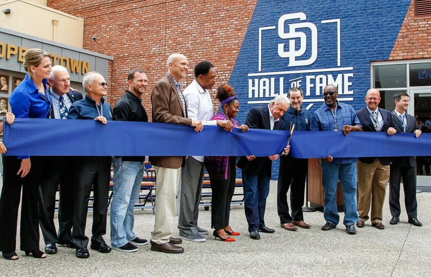 Inductee Randy Jones cuts the ribbon during the grand opening of the Padres Hall of Fame at Petco park on Friday in San Diego, California.