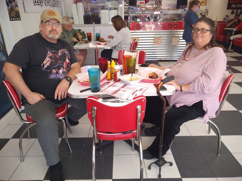 Meat Monsters Grill loyal patrons Chris and Terri Sinor chose to dine indoors on the first day of purple tier restrictions.
