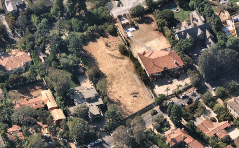 The empty lot covers nearly an acre in an affluent area of Brentwood.