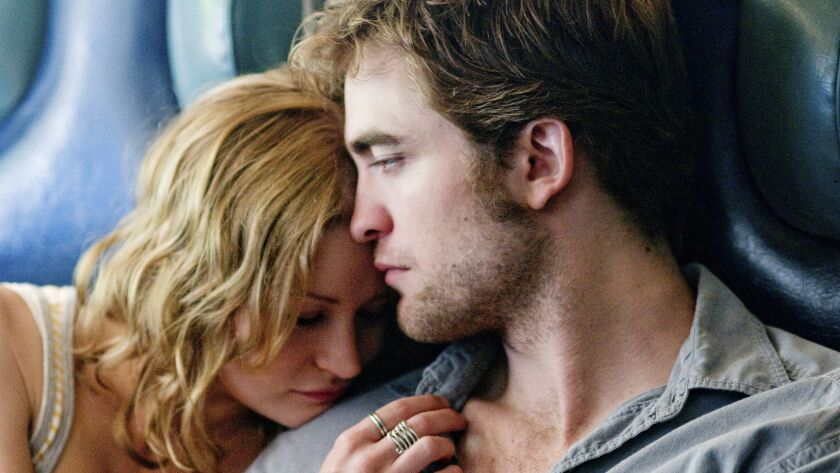 EMILIE DE RAVIN and ROBERT PATTINSON star in the movie REMEMBER ME