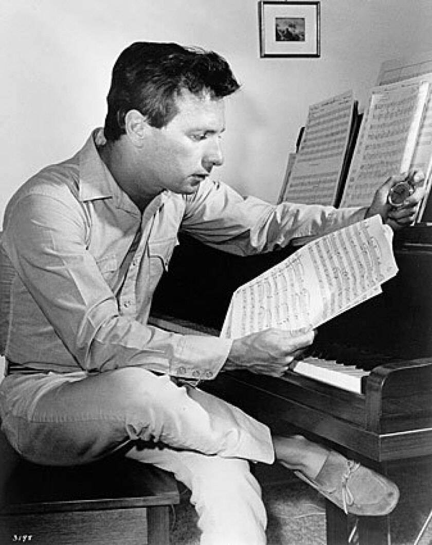 """As a brilliant young composer, Maurice Jarre studies his score for """"Doctor Zhivago,"""" which earned him his second of three Oscars. Jarre, whose many distinguished accomplishments included being made an officer of the French Legion of Honor for his contributions to culture, died Sunday in Los Angeles at age 84."""