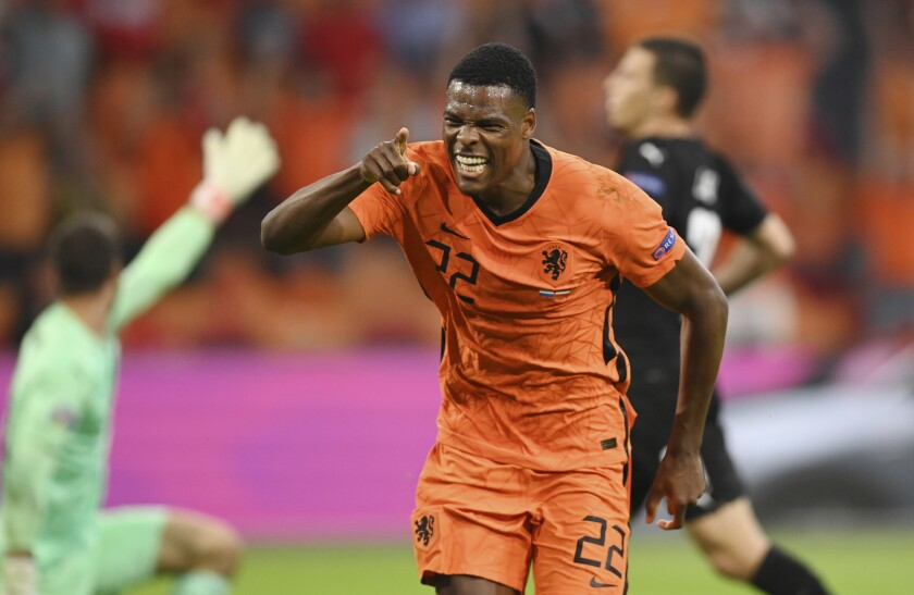 Denzel Dumfries of the Netherlands celebrates after scoring his side's second goal during the Euro 2020 soccer championship group C match between the The Netherlands and Austria at Johan Cruijff ArenA in Amsterdam, Netherlands, Thursday, June 17, 2021. (John Thys, Pool via AP)