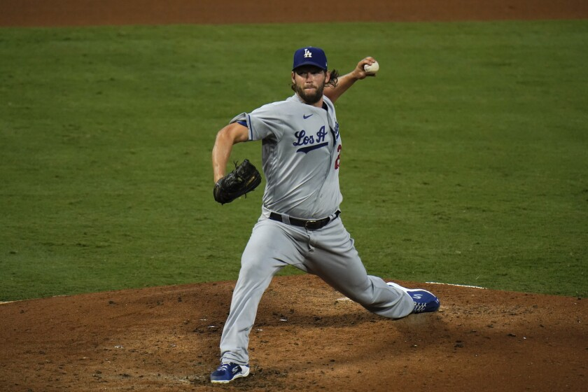 Dodgers starting pitcher Clayton Kershaw throws against the Angels.