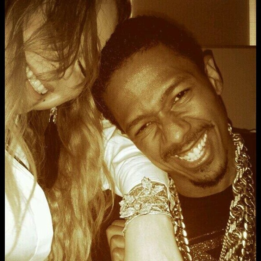"""Nick Cannon shows off his wife Mariah Carey's birthday present on Instagram. The """"America's Got Talent"""" host surprised her with a diamond-encrusted butterfly bracelet, which she promptly showed off on social media."""