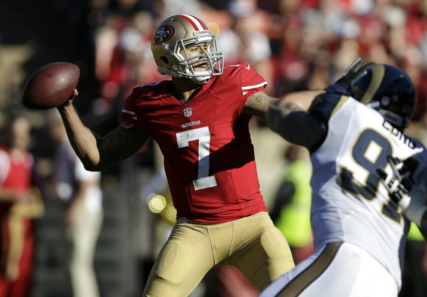 San Francisco 49ers quarterback Colin Kaepernick (7) passes as St. Louis Rams defensive end Chris Long (91) applies pressure during the second quarter of an NFL football game in San Francisco, Sunday, Dec. 1, 2013. (AP Photo/Marcio Jose Sanchez)