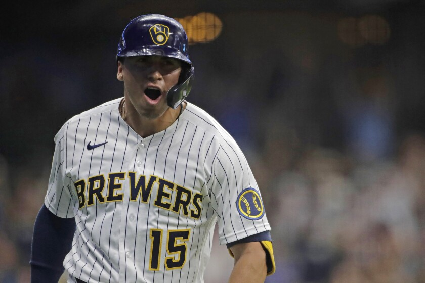 Milwaukee Brewers' Tyrone Taylor reacts after hitting a grand slam during the seventh inning of the team's baseball game against the Chicago White Sox on Friday, July 23, 2021, in Milwaukee. (AP Photo/Aaron Gash)