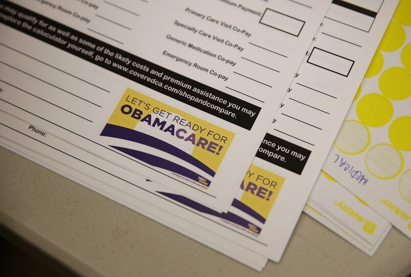 Forms to register for healthcare insurance are displayed during a healthcare enrollment fair at Ambrose Community Center in Bay Point, Calif. A bill to prohibit the hiring of certain felons from working for the state health exchange failed to advance in the Legislature on Tuesday.