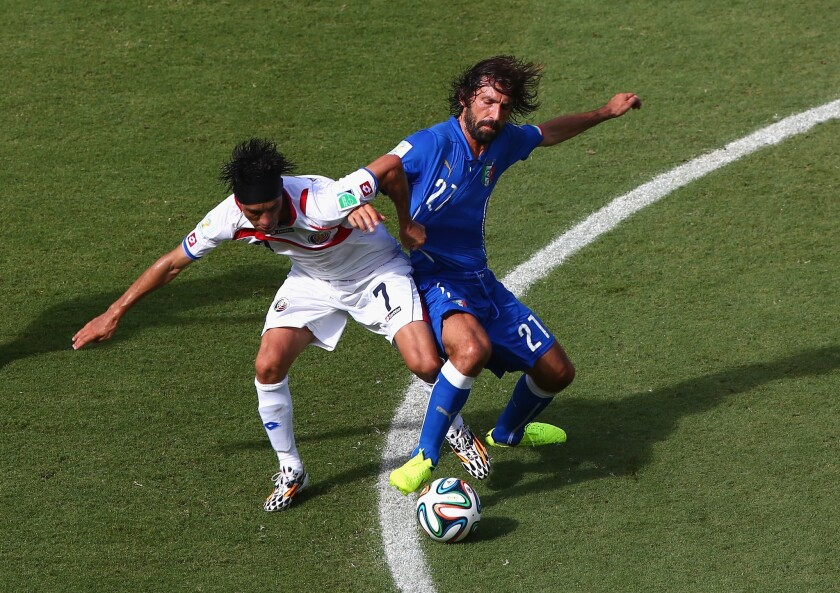 Christian Bolanos of Costa Rica and Andrea Pirlo of Italy compete for the ball during the 2014 FIFA World Cup Brazil match at Arena Pernambuco on Friday in Recife, Brazil.