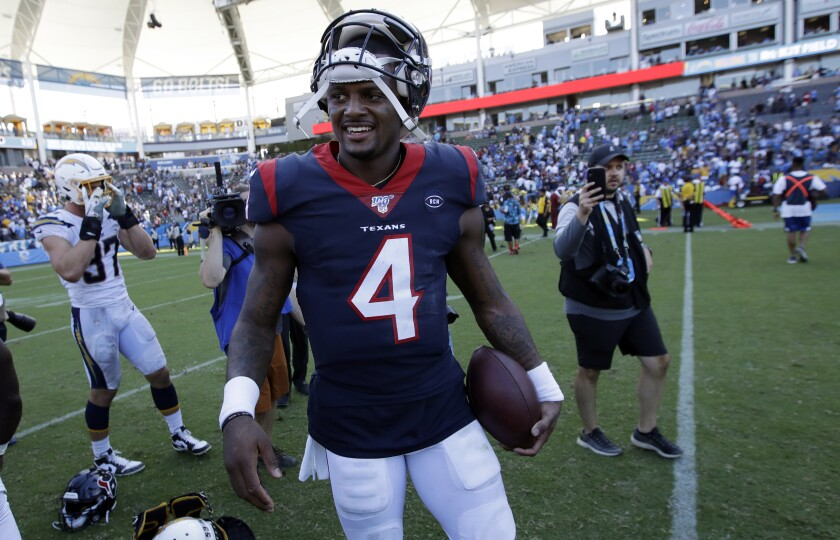 Houston Texans quarterback Deshaun Watson (4) smiles after a win over the Los Angeles Chargers on Sunday in Carson.