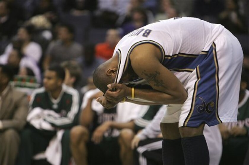 Washington Wizards' Caron Butler bends over after apparently suffering an eye injury, during the third quarter of the Wizards' 97-91 loss to the Milwaukee Bucks in an NBA basketball game in Washington, Monday, Jan. 12, 2009. (AP Photo/Lawrence Jackson)