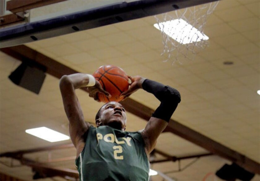 Poly's Jordan Bell goes up for a dunk during a game against Loyola in the Southern Section 1AA quarterfinal.