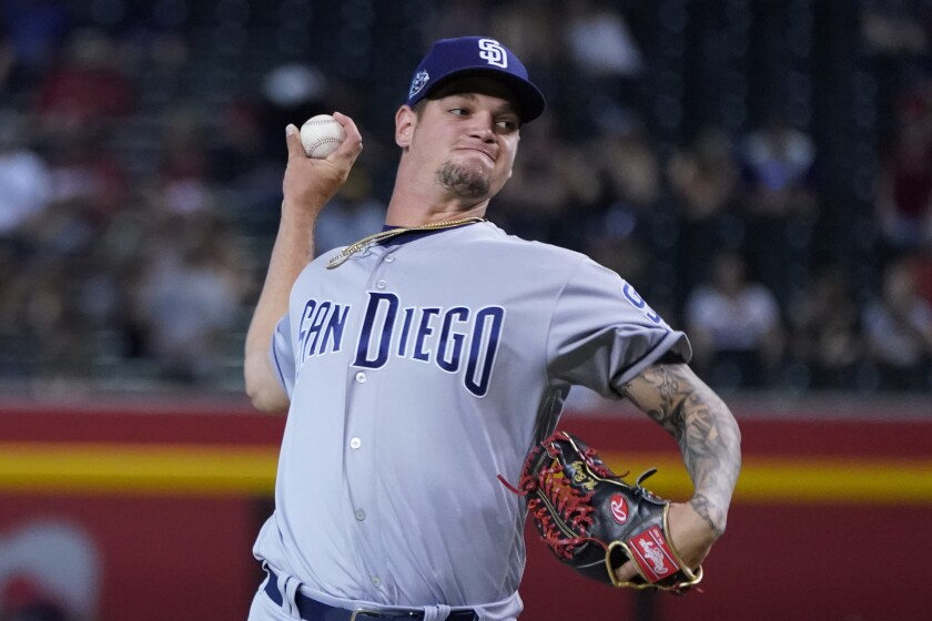 San Diego Padres relief pitcher Michel Baez (49) throws against the Arizona Diamondbacks in the seventh inning during a baseball game, Monday, Sept. 2, 2019, in Phoenix. (AP Photo/Rick Scuteri)