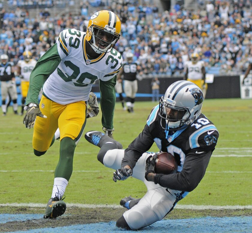 Carolina Panthers' Corey Brown (10) catches a touchdown pass as Green Bay Packers' Demetri Goodson (39) defends in the first half of an NFL football game in Charlotte, N.C., Sunday, Nov. 8, 2015. (AP Photo/Mike McCarn)