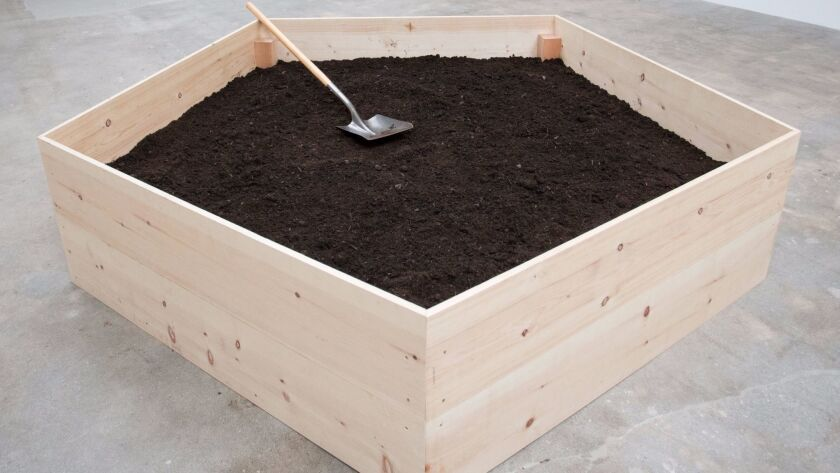 """The Harrisons' """"Composting in the Pentagon With Worm Tailings,"""" 2017. Wood, 2,000 red worms, steer manure, chicken manure, soil, compost and plastic sheeting."""