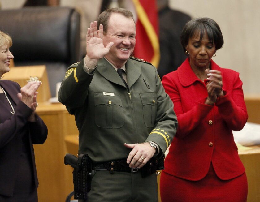 Jim McDonnell, left, is sworn in as the new Los Angeles County Sheriff's by Los Angeles County District Attorney, Jackie Lacey, right, on Dec. 1. He replaces Lee Baca, who retired in January amid a federal investigation of alleged county jail corruption and abuse.