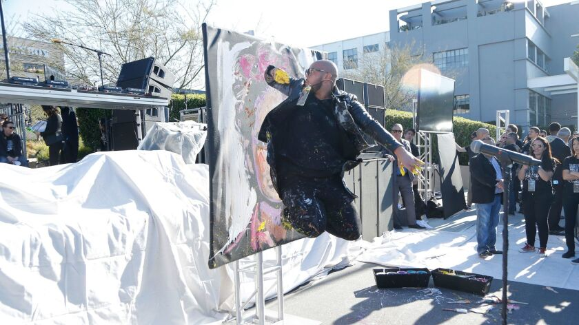 Artist David Garibaldi did a painting performance at the United Voices rally organized by United Talent Agency in Beverly Hills.
