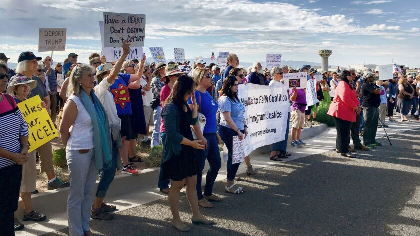 Demonstrators rally in support of Iraqi refugee Kadhim Al-bumohammed outside of Immigration and Customs Enforcement offices in Albuquerque, N.M., on July 13.