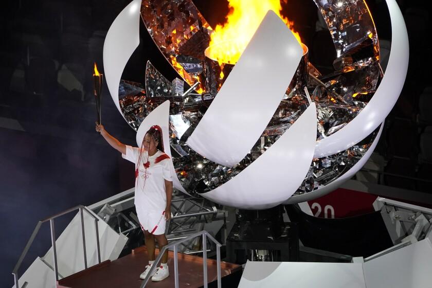 Naomi Osaka lights the Olympic cauldron