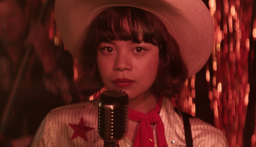 """This image released by Sony Pictures shows Eva Noblezada in a scene from """"Yellow Rose."""" (Sony Pictures via AP)"""
