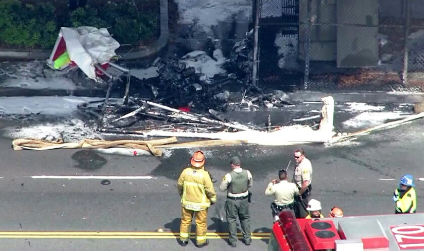 Authorities examine the wreckage of a light-sport plane crashe near Hawthorne Municipal Airport.