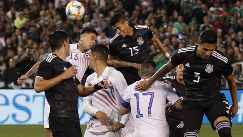 Mexico's Hector Moreno, above right, heads the ball in for a goal during the second half of an international friendly soccer match against Chile on Friday in San Diego.