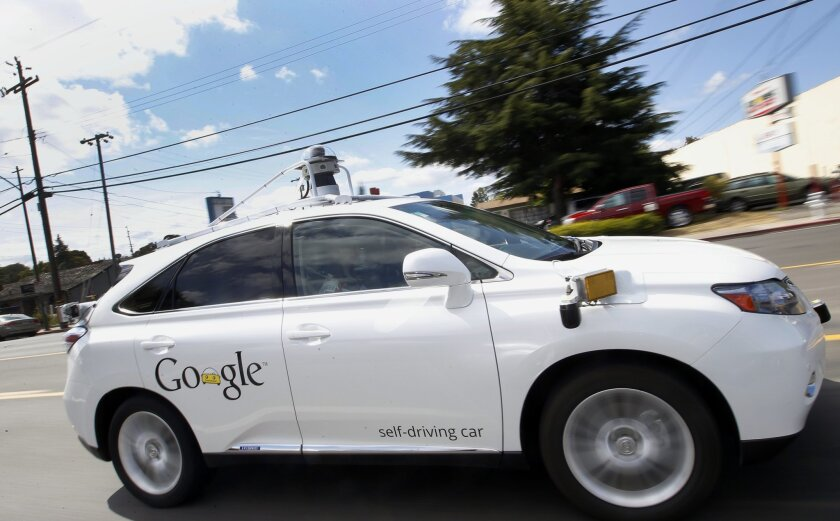 FILE - In this May 13, 2015, file photo, Google's self-driving Lexus car drives along street during a demonstration at Google campus in Mountain View, Calif. A self-driving car being tested by Google struck a public bus on a city street, a fender-bender that appears to be the first time one of the tech company's vehicles caused an accident. The collision occurred on Valentine's Day and Google reported it to California's Department of Motor Vehicles in an accident report that the agency posted Monday, Feb. 29. (AP Photo/Tony Avelar, File)