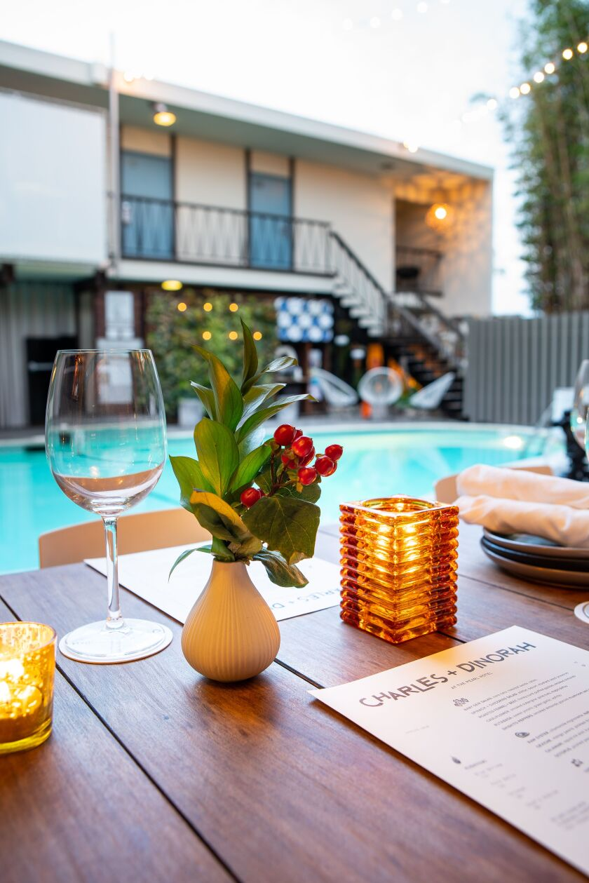 Charles + Dinorah's poolside patio at The Pearl Hotel is retro cool.